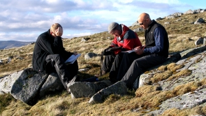 Map Reading Courses, time for a break to build a navigation strategy. A fine day in the Scottish Highlands.