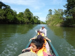Motorised canoe river journey back to town.