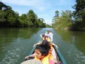 Motorised canoe river journey back to town.