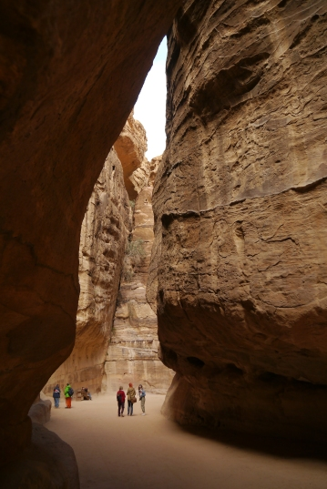 The cliffs close in on the track down Petra Siq