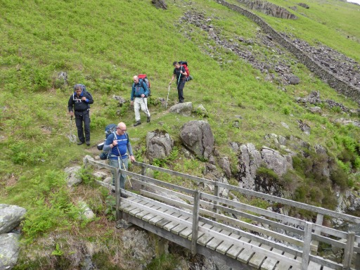 Crossing Over Beck, just below Dropping Crag on Yewbarrow.  Adrian leading the way.
