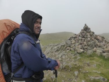 Nas reaches the summit of Crag Fell.